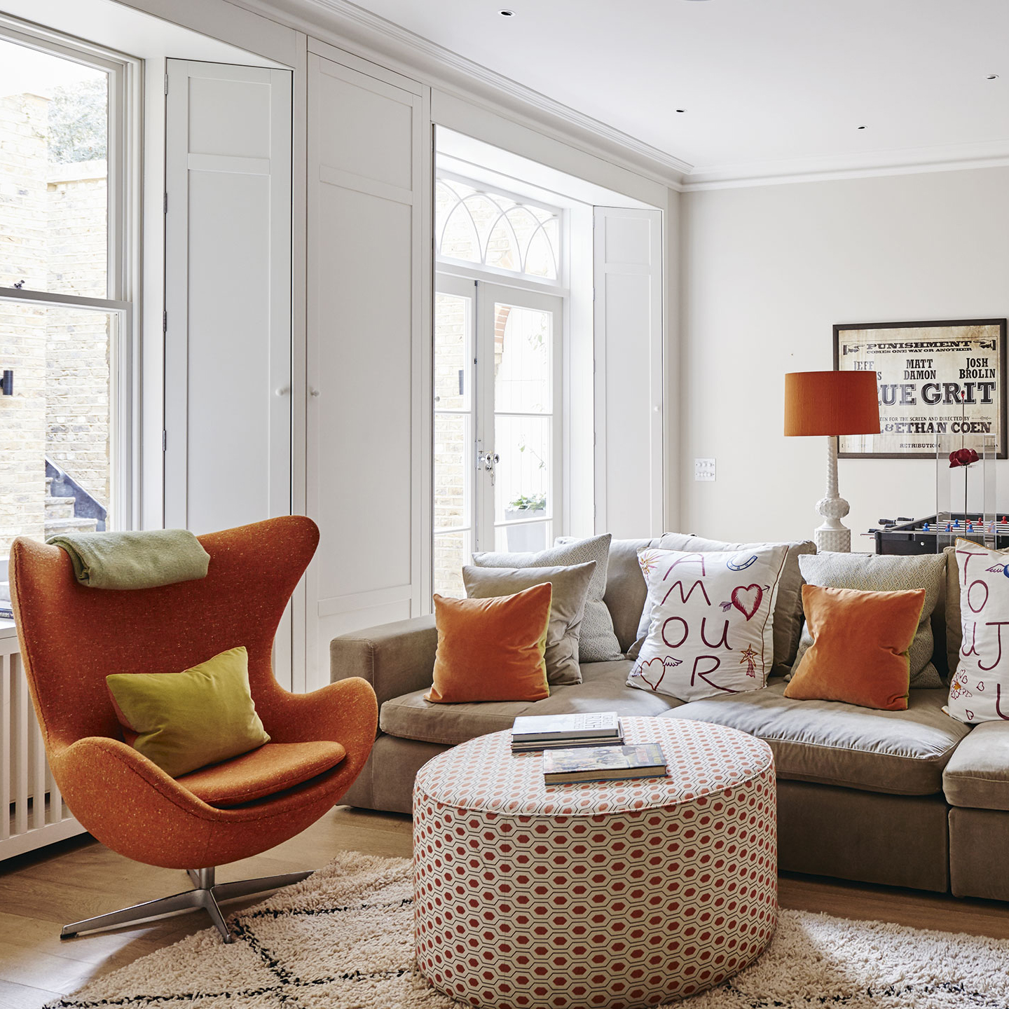 white-living-room-with-orange-accents